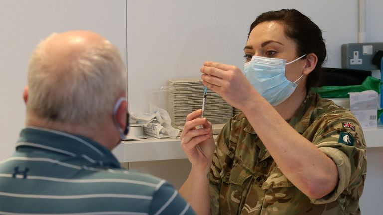 James Logan from Edinburgh, receives an injection of a coronavirus vaccine from military personnel who are assisting with the vaccination programme at the Royal Highland Showground near Edinburgh. Picture date: Thursday February 4, 2021.