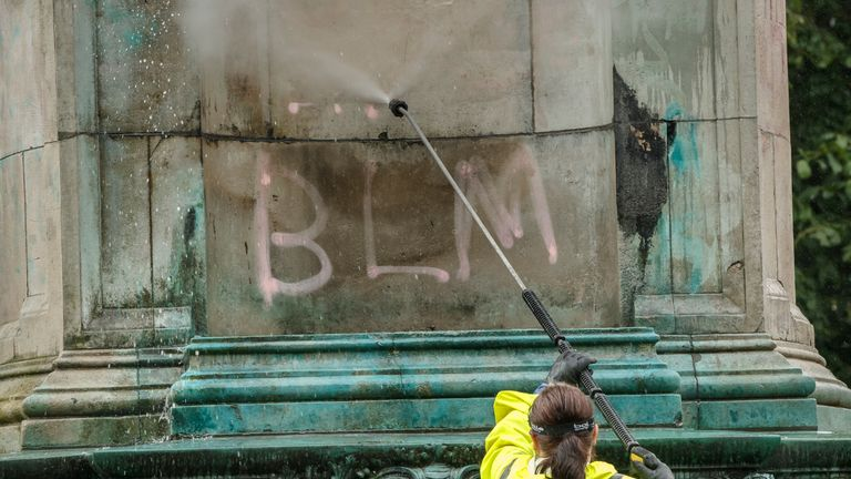 "Council workers clean graffiti, that included the letters ""BLM"" and the words ""murderer"" and ""slave owner"", from a statue of Queen Victoria in Woodhouse Moor, Leeds, following a raft of Black Lives Matter protests that took place across the UK over the weekend. The protests were sparked by the death of George Floyd, who was killed on May 25 while in police custody in the US city of Minneapolis."