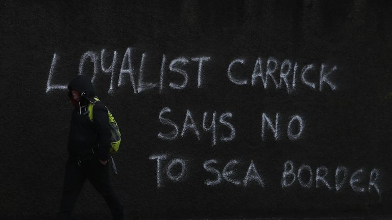 Graffiti on the A2 outside Carrickfergus in Belfast. The DUP has rejected claims it is whipping up tensions over Irish Sea trade in an effort to get Brexit's contentious Northern Ireland Protocol ditched. Physical inspections on goods entering Northern Ireland from Great Britain, which are required under the protocol, have been suspended amid threats and intimidation of staff. Picture date: Wednesday February 3, 2021.