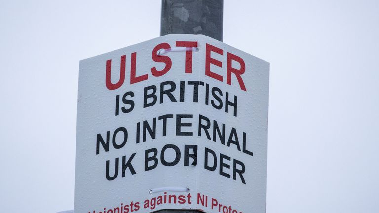 A sign on a lamppost that reads 'Ulster is British - no internal UK Border - Unionists against NI Protocol', opposite the Department of Agriculture, Environment and Rural Affairs (DAERA) Redlands site. It will be used to inspect animal products travelling from Great Britain into Northern Ireland after the post-Brexit transition period at the end of the year.