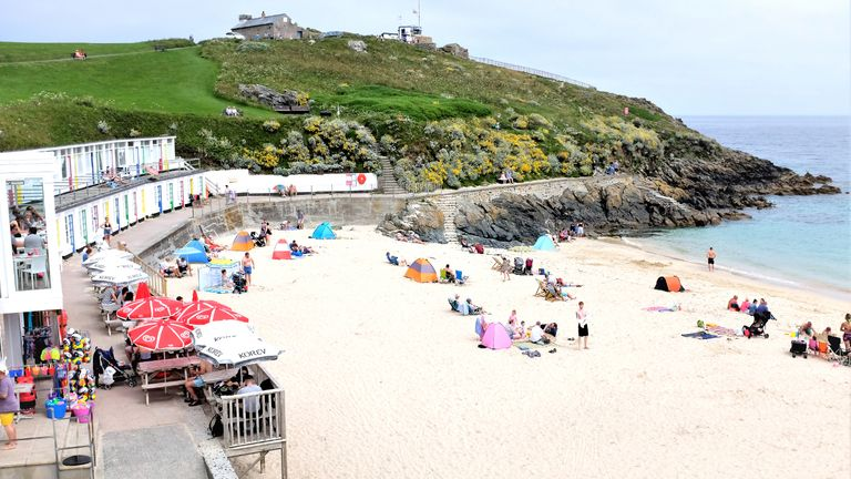St. Ives, Cornwall, UK. June25, 2019. Holidaymakers enjoying the sheltered sand of Porthgwidden beach at St. Ives in Cornwall, UK.