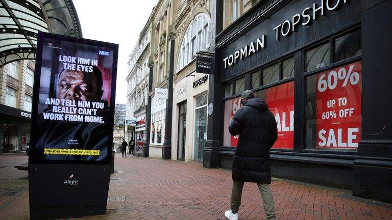 A person makes their way past a government coronavirus sign on Old Christchurch road in Bournemouth, Dorset, during England's third national lockdown to curb the spread of coronavirus. Picture date: Tuesday February 16, 2021.