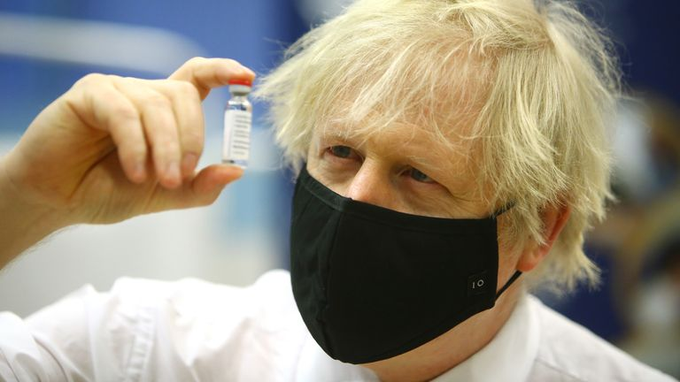 Prime minister Boris Johnson holding a vial of the Oxford/Astra Zeneca Covid-19 vaccine as he visits a vaccination centre at Cwmbran Stadium in Cwmbran, south Wales. Picture date: Wednesday February 17, 2021.