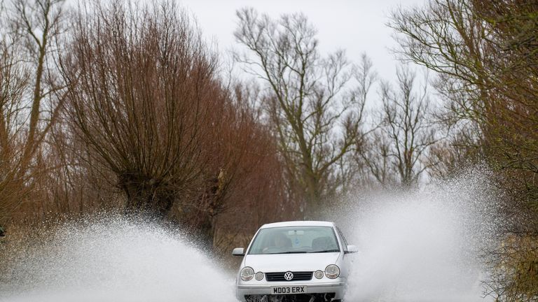 Cars drive along the A1101 in Welney, Norfolk, which is passable again after two months submerged. Picture date: Thursday February 18, 2021.