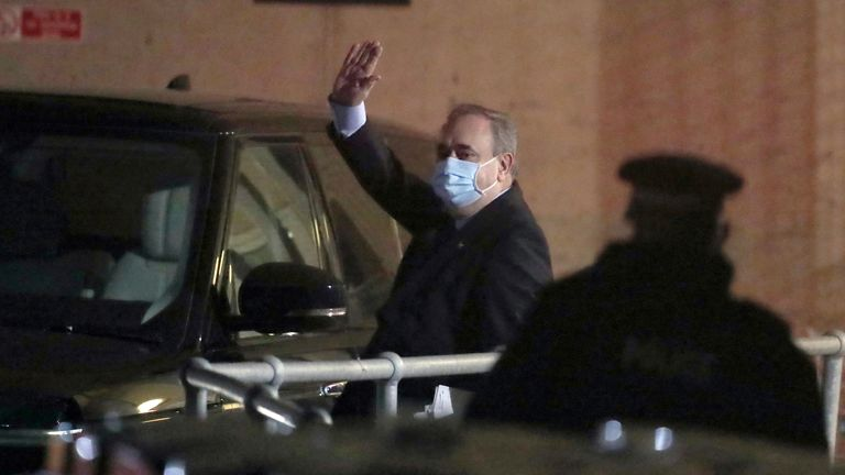 Former first minister Alex Salmond waves as he leaves Holyrood in Edinburgh