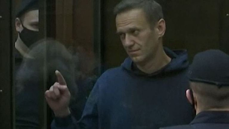 Alexei Navalny draws a heart as he is sentenced to prison