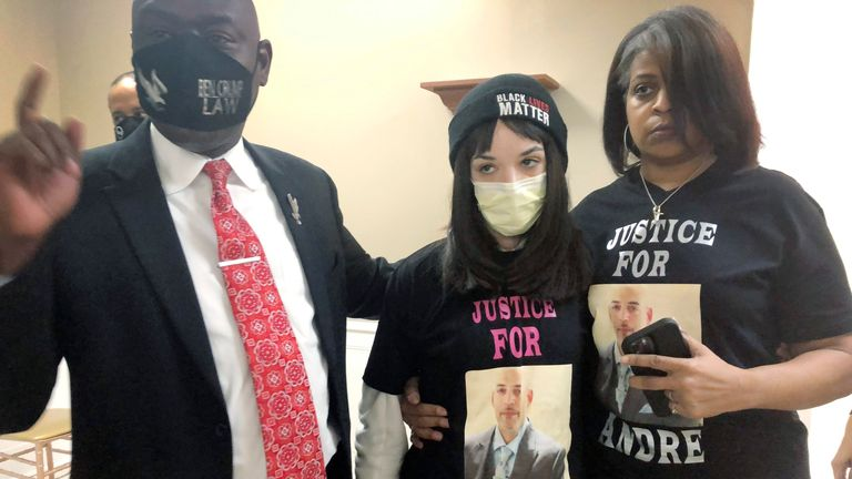 Andre Hill's daughter, Karissa (C), with Hill's sister Shawna Barnett and lawyer Benjamin Crump. Pic: AP