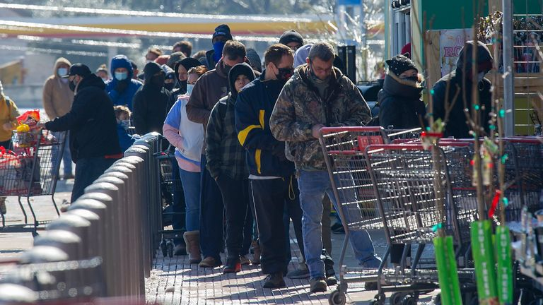 People in Austin queueing to enter a supermarket. Pic: AP