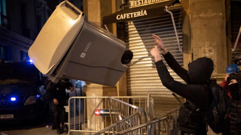 Demonstrators threw rubbish bins at police officers. Pic: AP