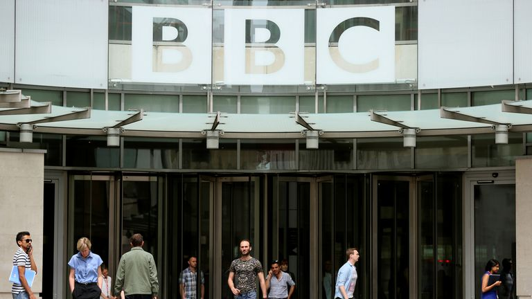 FILE PHOTO: People arrive and depart from Broadcasting House, the headquarters of the BBC, in London Britain July 2, 2015. REUTERS/Paul Hackett/File Photo