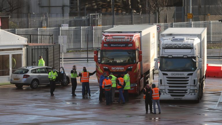 FACES OF BORDER FORCE OFFICERS AND VEHICLE NUMBER PLATE PIXELLATED BY PA PICTURE DESK Lorry drivers and officials talk at the DEARA site near Belfast Port, as the UK leaves the single market and customs union and the Brexit transition period comes to an end.