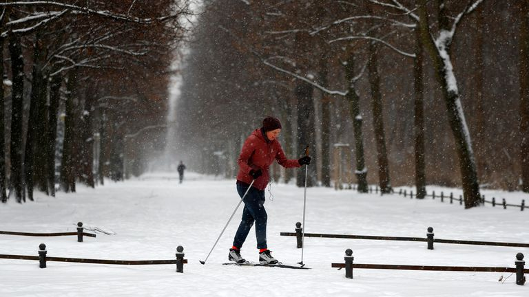 A woman skies during snowfall at Tiergarten park in Berlin, Germany, February 9, 2021. REUTERS/Fabrizio Bensch