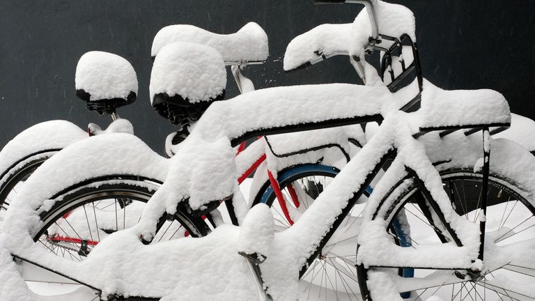 Bicycles covered in snow in Nijmegen in the Netherlands