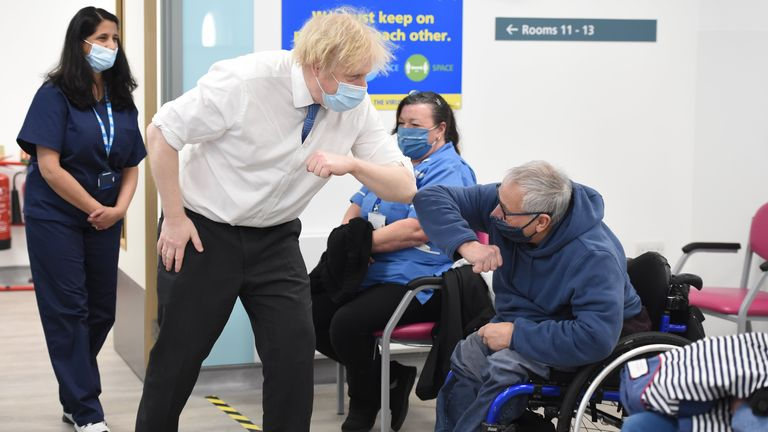 Prime Minister Boris Johnson meets Tony Garrett during a visit to a coronavirus vaccination centre at the Health and Well-being Centre in Orpington, south-east London. Picture date: Monday February 15, 2021