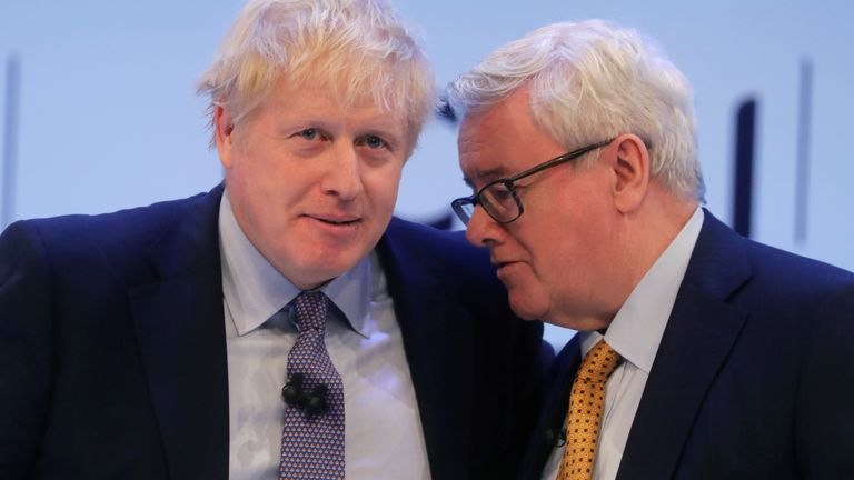 Britain's Prime Minister Boris Johnson and President of the Confederation of British Industry John Allan attend the annual CBI Conference in London, Britain November 18, 2019