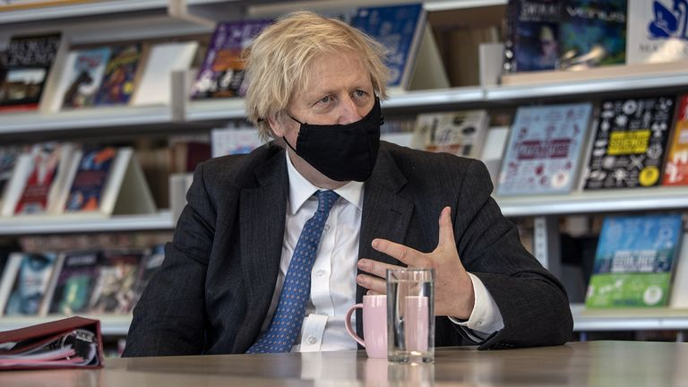 Prime Minister Boris Johnson meets with teachers in the library during a visit to Sedgehill School in Lewisham, south east London, to see preparations for students returning to school. Picture date: Tuesday February 23, 2021.