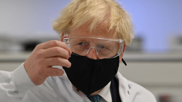Prime Minister Boris Johnson holding a vial of the Oxford/AstraZeneca vaccine