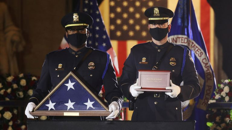 U.S. Capitol Police Officers carry the urn holding the remains of fellow officer Brian Sicknick, who died on January 7 from injuries he sustained while protecting the U.S. Capitol during the January 6 attack on the building, to lie in honor in the Capitol Rotunda at the U.S. Capitol in Washington, U.S., February 2, 2021. REUTERS/Leah Millis/Pool