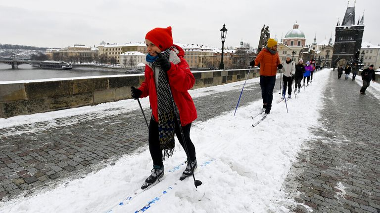 People have being skiing across Prague's Charles Bridge