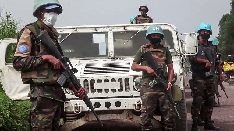United Nations peacekeepers guard the area where the convoy was attacked