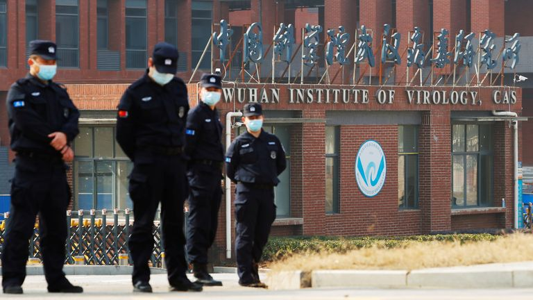 Security personnel keep watch outside Wuhan Institute of Virology during the visit by the World Health Organisation (WHO) team tasked with investigating the origins of the coronavirus disease in Wuhan, Hubei province, China