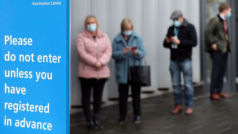 A queue of people wait in line for their injection at the mass vaccination programe in Newcastle Upon Tyne, Monday, Jan. 11, 2021, during England's third national lockdown to curb the spread of coronavirus. (AP Photo/Scott Heppell)