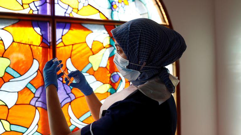Nurse Zenub Mahood prepares a dose of the AstraZeneca coronavirus disease (COVID-19) vaccine, at Bradford Central Mosque,
