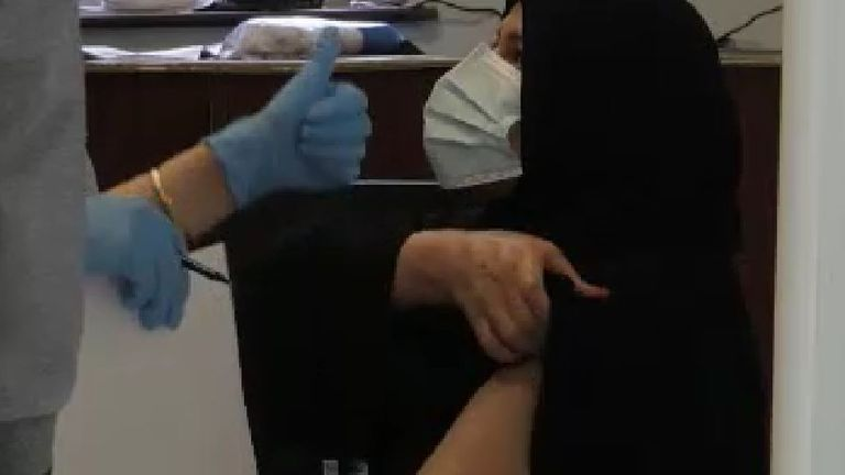 A woman gets a jab at the Al-Abbas mosque