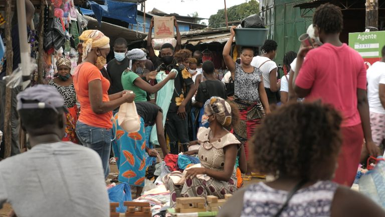 Shoppers crowd the market in Maputo, Mozambique, seemingly unaware of the rising number of coronavirus cases