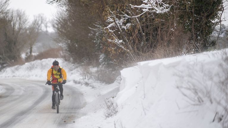 A cyclist makes his way through snow in Barham near Ipswich