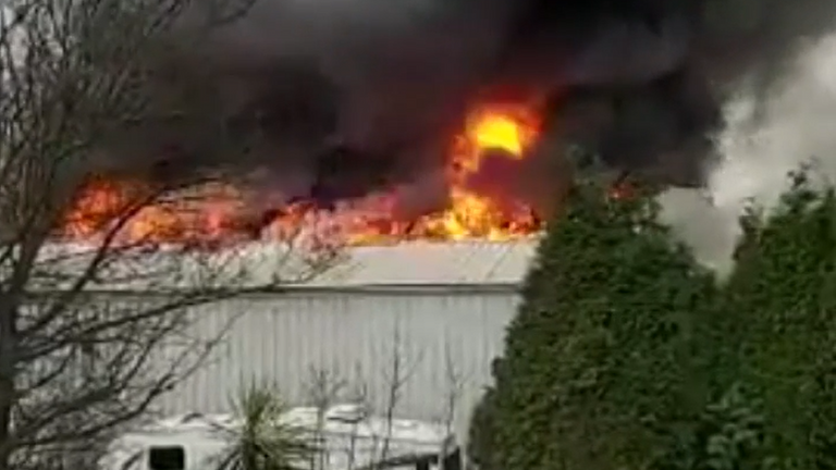 Buildings have been evacuated in Denton, Greater Manchester after a huge fire at a three-storey warehouse