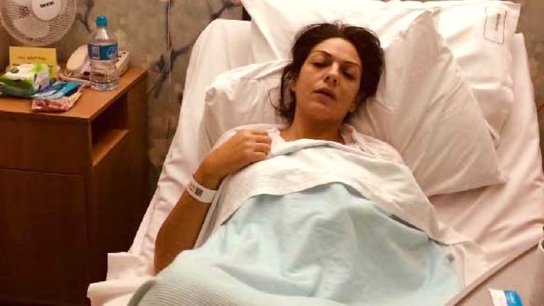 Undated handout file photo issued by the CPS of Nicole Elkabbas, lying in a hospital bed, where she conned kind-hearted members of the public out of thousands using a GoFundMe page by faking having cancer, as she is to be sentenced on Wednesday. Issue date: Wednesday February 10, 2021. file pic from PA