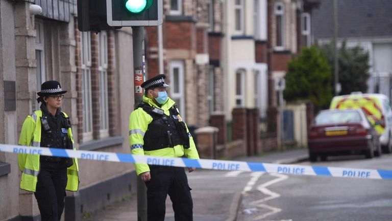Police remain at the scene of the blaze