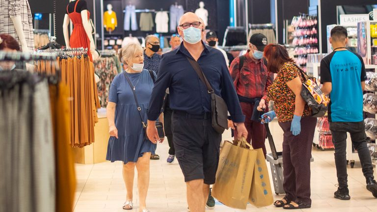 Customers wear face masks as they shop inside Primark in Oxford Street, London
