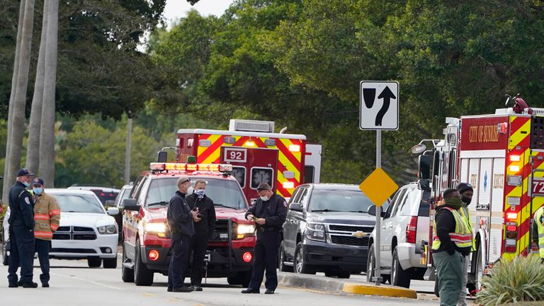Law enforcement officers block an area where a shooting killed two FBI agents. Pic: AP Photo/Marta Lavandier