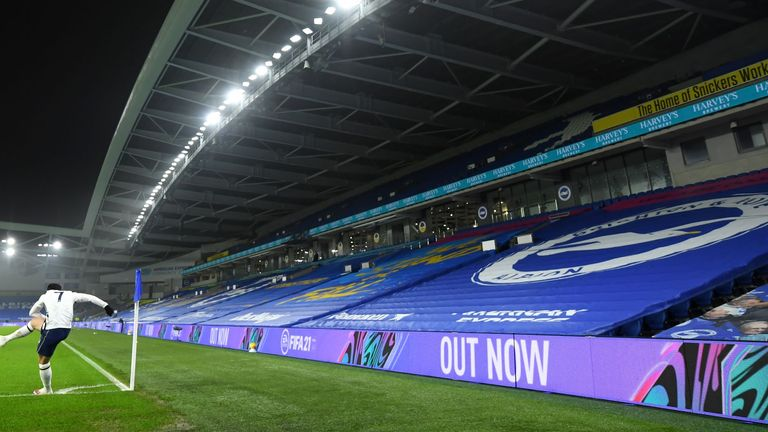 Tottenham Hotspur's Son Heung-min takes a corner in front of the empty stands during the Premier League match at the AMEX Stadium, Brighton. Picture date: Sunday January 31, 2021.