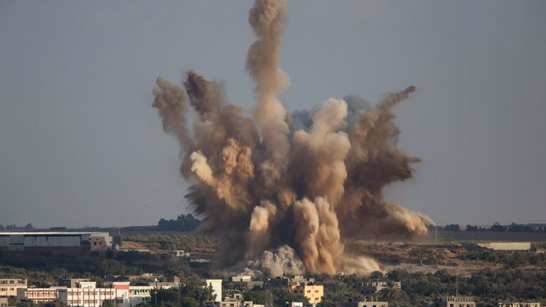 Smoke rises in Gaza City after an Israeli airstrike in August 2014