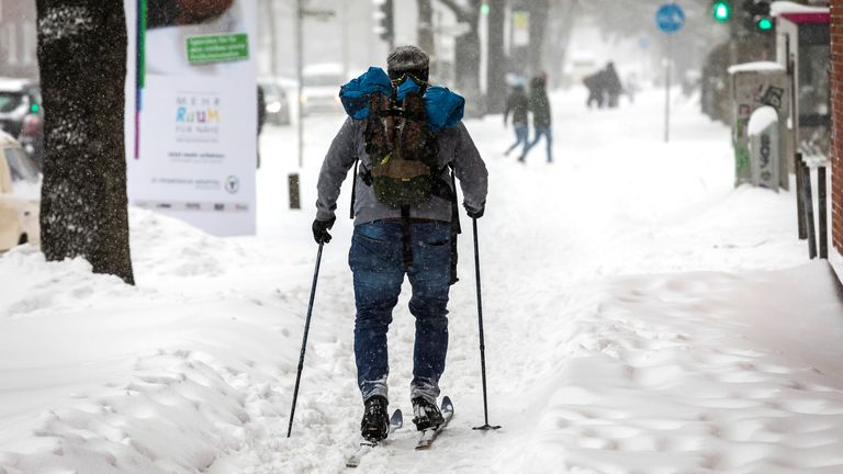 A man on ski makes his way in Muenster, Germany, February 7, 2021, as the bad weather hit a band running from Muenster in the west to Saxony in the east, with an area to the south of Hanover hit hardest. REUTERS/Lars Berg NO RESALES. NO ARCHIVES