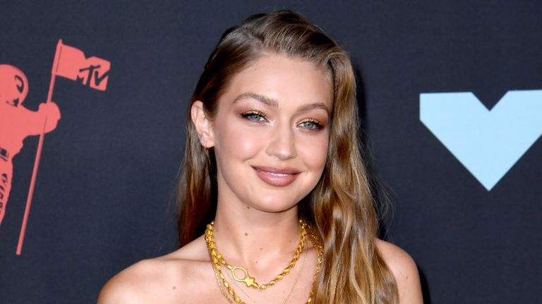 Gigi Hadid said she wasn't as small as she used to be but had no intention of rushing back to size zero for the Vogue shoot