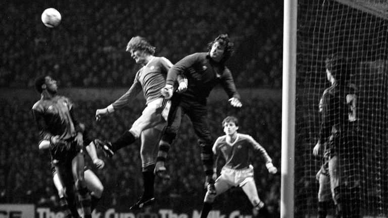 File photo dated 23-02-1983 of Arsenal goalkeeper Pat Jennings punches clear from Manchester United's Gordon McQueen (centre left). Issue date: Tuesday February 23, 2021.