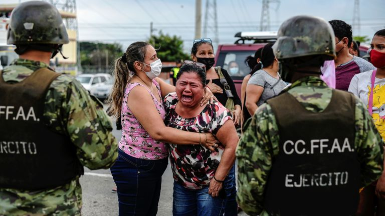 A woman reacts outside a prison where inmates were killed during a riot that the government described as a concerted action by criminal organisations, in Guayaquil, Ecuador February 23, 2021.