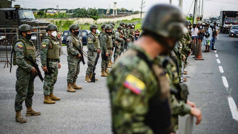 Soldier stand guard outside a prison where inmates were killed during a riot that the government described as a concerted action by criminal organisations, in Guayaquil, Ecuador February 23, 2021.
