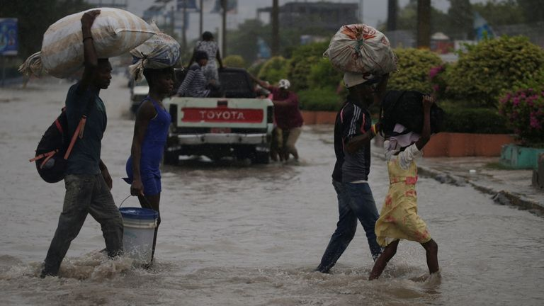 A flooded street in Haiti during Tropical Storm Laura
