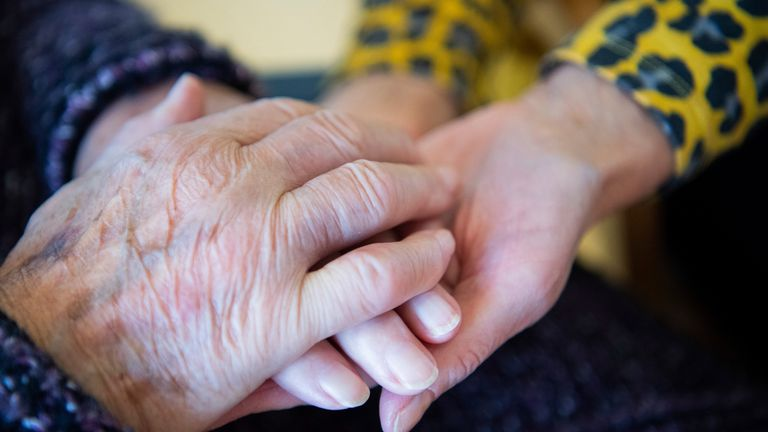 Hand holding at care home. Pic: AP