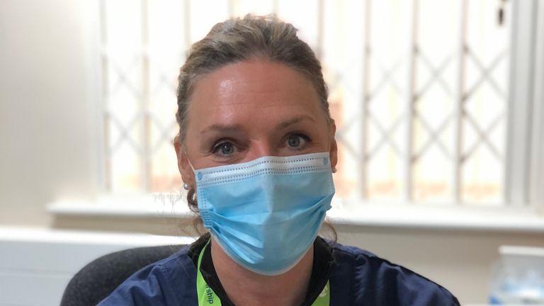 Heather Munroe in scrubs