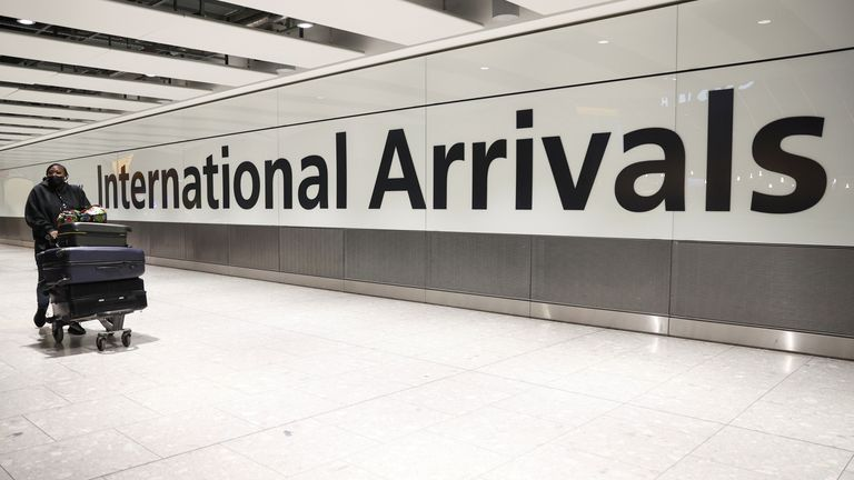 A traveller arrives at Heathrow Airport