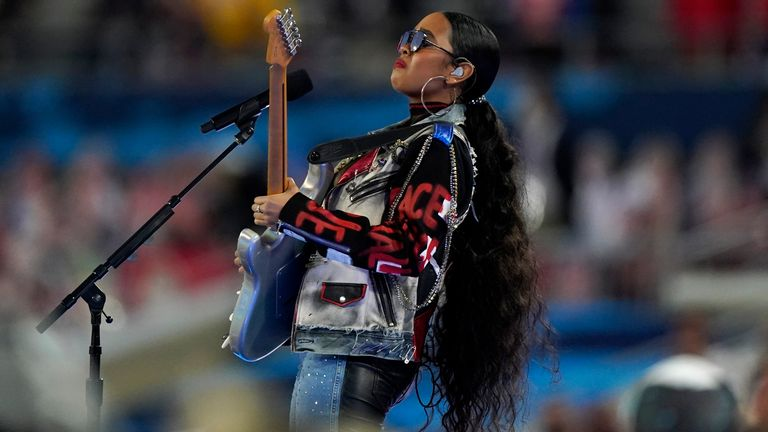H.E.R performed America the Beautiful before the game. Pic: Associated Press