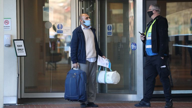 A guest leaves the Holiday Inn hotel near Heathrow Airport, London, after completing their 10-day stay
