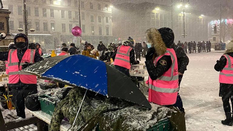 Homeless people line up while waiting to get food amid freezing weather in Glasgow. Pic: Kindness Homeless Street Team
