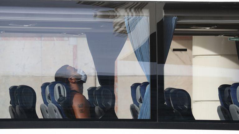 A passenger arrives at a quarantine hotel at Heathrow